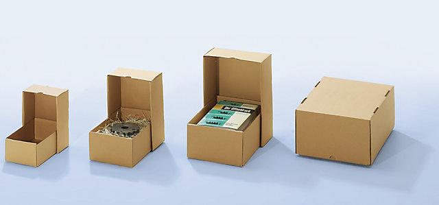 Четыре картонные коробки разных размеров