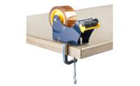 Table dispenser for self-adhesive tape